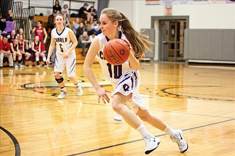 Charlo's Kaitlin Cox races to the hoop.