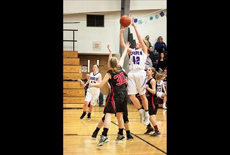 Charlo Lady Viking Liev Smith shoots a jumper over defenders.