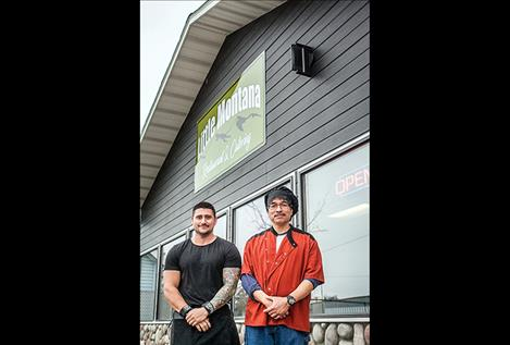 Owners of Little Montana, Sean Perry and Guy Hill, stand at the entrance of their new restaurant.