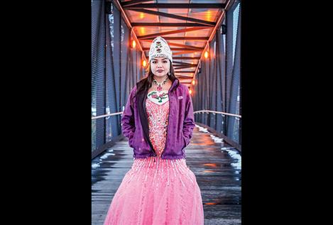 Lene Trahan is the reigning Miss Salish Pend d'Oreille. She is on the bridge in Pablo.
