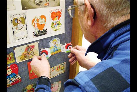 Gil Mangels looks at one of the 400 antique valentines on display at Miracle of America Museum.