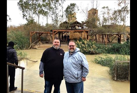 Pastors Jason Burrough and Chriss Sopke stand on the banks of the Israeli side of the Jordan River.