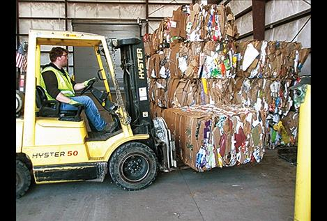 Zack Mooso loads recyclables on a forklift.