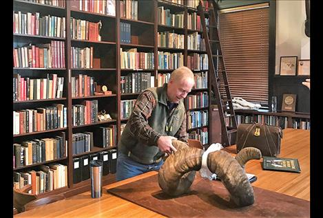 Jim Williams, Region 1 supervisor for Montana Fish, Wildlife & Parks, measures the pending world-record bighorn ram at the Boone & Crockett Club headquarters in Missoula.