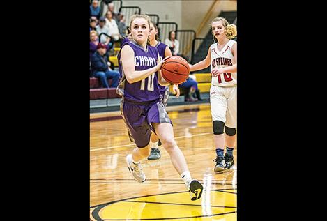 Lady Viking Kaitlin Cox races to the hoop.