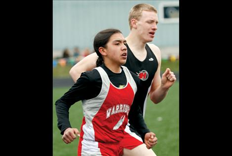 Zach Felsman keeps pace with a Hot Springs runner at the Ronan meet last week.