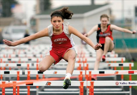 Rebecca Whitesell nears the finish of the girls' 100-meter hurdles at the Ronan Invitational last week.