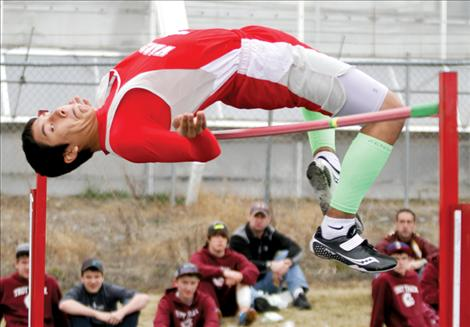 Warrior PJ Haynes clears the high jump  during competition at the Ronan Invitational track meet last week.