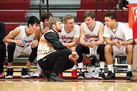 : Warriors' coach Zanen Pitts talks with his bench in the waning moments of the fourth quarter.