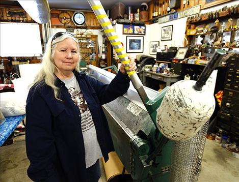 Lee Bridges stands in her sheet metal fabrication shop on her property in East Missoula where she lives. Bridges wants her community to come up with its own zoning designations through Missoula County rather than be zoned by the City of Missoula once they are annexed.