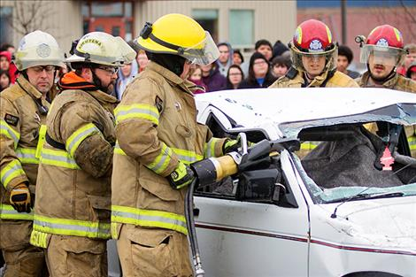"A Ronan fire-rescue team uses ""Jaws of Life"" during the Ghost Out event."
