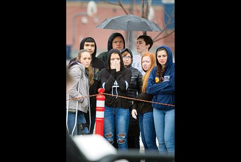 Ronan High School students react to a mock crash scene during a Ghost Out event.