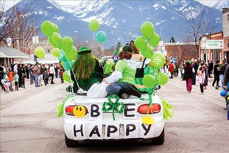 With the majestic Mission Mountains as a backdrop, children and adults line Main Street in Ronan for the annual St. Patrick's Day parade.