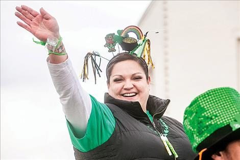 ll smiles, parade participants show their spirit with  a bit o' the Irish  symbols and colors.