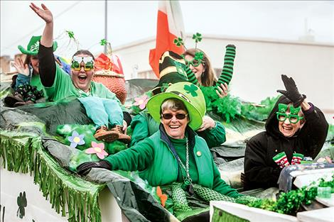 Ronan resident Carlene Bockman and her crew of enthusiastic ladies float down the parade route Saturday in Ronan.