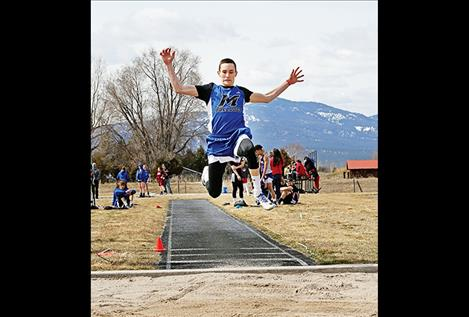 Mission Bulldog Flint McPherson flies through the air in the Long Jump at the Jim Johnson Invitation at Frenchtown Thursday, March 29.
