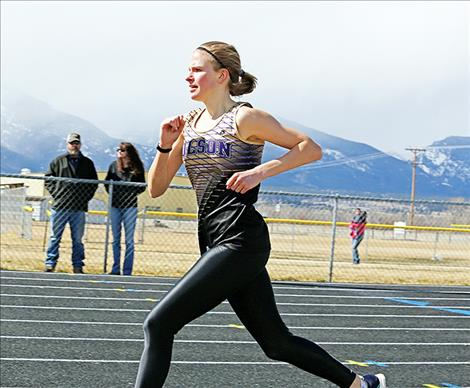 Polson's Bea Frissell heads down the final stretch of the 800-meter at the Gene Hughes Invitational track meet on March 24. She finished in 2:32.37 seconds earning the Polson Varsity Girls their only first place in Corvallis.