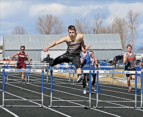 Polson's Colton Cote clears the final hurdle of the 300-meter hurdles at the Gene Hughes Invitational on March 24. Cote won the event with a time of 50.02 seconds.