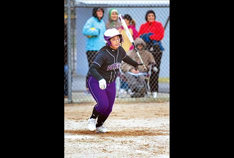 Polson Pirate Kaylanna DesJarlais watches as her ball drops for a base hit.