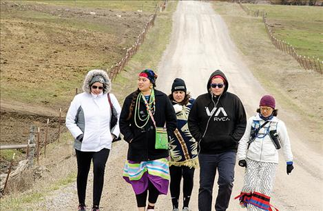 Lauren Chief Elk, Marita Growing Thunder, Shannon Ahhaitty, Erica Shelby and Kyan Bishop walk on the back roads near St. Ignatius to raise awareness about the issue of missing or murdered indigenous women.