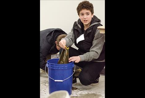 Daxter Stone, seventh grader, learns to clean a boot to  prevent contaminated water from getting into any other body of water.