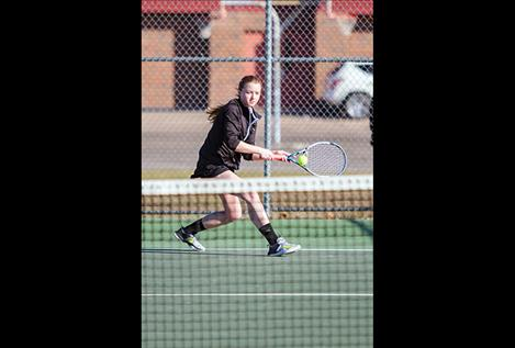 Polson Lady Pirate Shea McGuinness runs down a serve during her match against Libby.