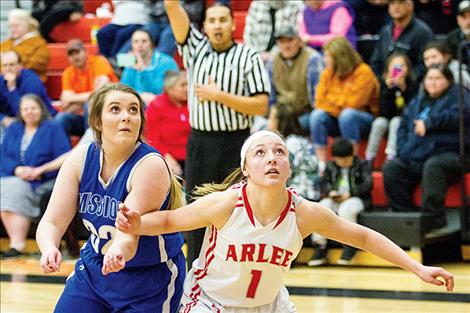 Arlee Scarlet Noelle West and Mission Lady Bulldog Leila Marsh battle for a rebound.