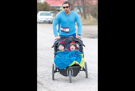 Jaxon, Jade and dad Jason Fuhrmann cross the finish line.