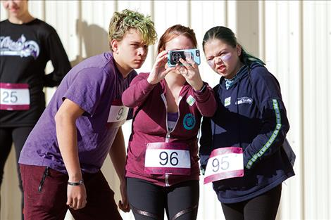 A trio of runners take a selfie before the big race.