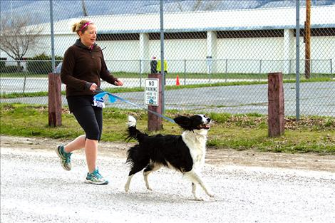 Kathryn McEnery, of Hot Springs, and her furry companion set out on a half-marathon adventure.
