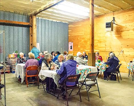 People gather at an appreciation celebration located at the Bread Basket.