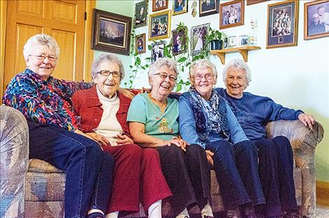 Strong family bonds bring five sisters home