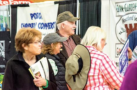 Sheriff Don Bell visits with people at his booth during the event.
