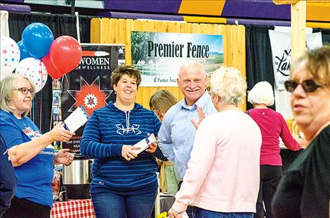 David Coffman talks to people about his run for sheriff during the Mission Valley Spring Trades Show and Business Expo on April 28 at Polson High School.