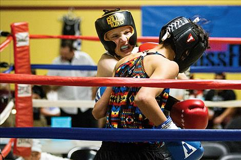 Kellan Norman lands a punch on the chin of his opponent.