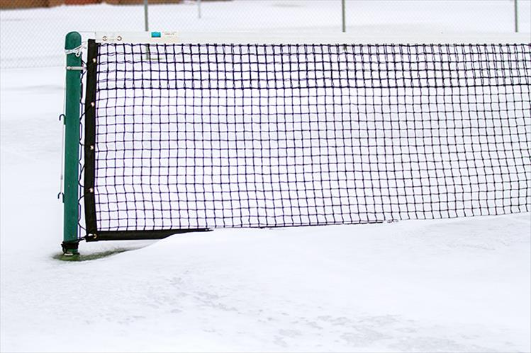 Polson's tennis courts were covered in snow last week.