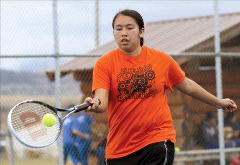 Amber Quequesah returns the ball during her match against Mission's Briar Ahlborn March 28 in St. Ignatius.