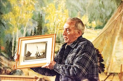 Local resident Wyman  McDonald shows a photo  of Sundown, his cousin.