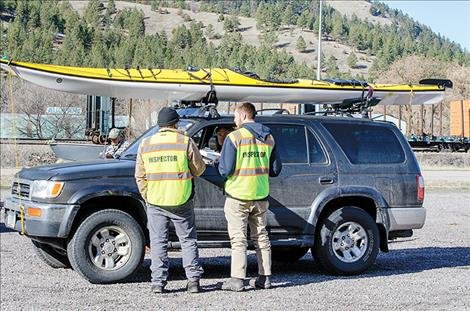 All watercraft, including kayaks, rafts and stand-up paddleboards, must stop at the AIS inspection station in Ravalli.