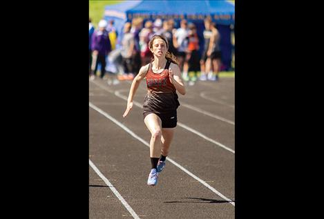 Ronan Maiden Kinsely Barney sprints to a first-place finish in the 100-meter.
