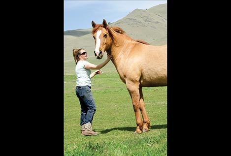 Danyea Logan-Young spends time with a horse she rescued.