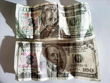 Counterfeit $20 and $100 bills like the ones pictured have been circulating in the Polson area.
