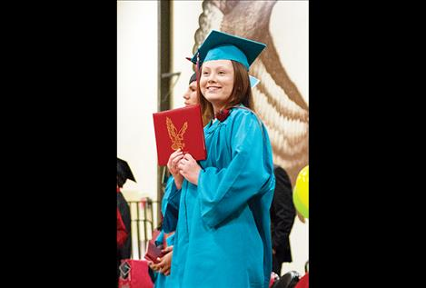 Alexia Parizeau poses with her diploma.
