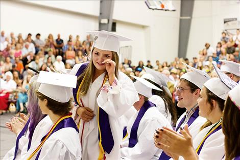 Salutatorian Aislynn Love wipes a tear as she walks to the stage to deliver her address.