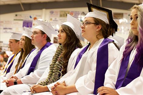 Charlo's class of 2018 listens intently as a  former teacher gives the commencement address.