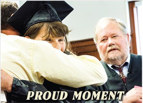 Karen Tromp gets a hug from Chemical Dependency Counselor Jay Brewer as the first graduate of Lake County Drug Court.