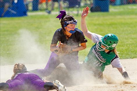 The Lady Pirates attempt to turn a double play.