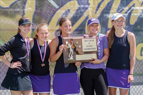 Polson High School girls tennis teammates Shea McGuinness, Berkely Ellis, Kyler Lundeen, Josie Peterson and Qia Harlan pose for a photo with the state trophy.