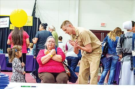 U.S. Public Health Service representative Jason Krumbeck teaches people about balance issues.