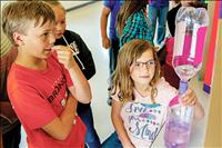 Second grade students show off smarts at science fair